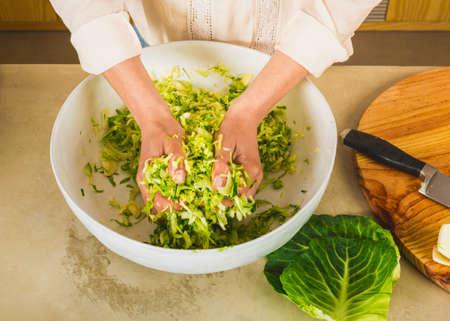 Preparing fermented preserved vegetables. Cabbage kimchi and sauerkraut sour cabbage.  스톡 콘텐츠