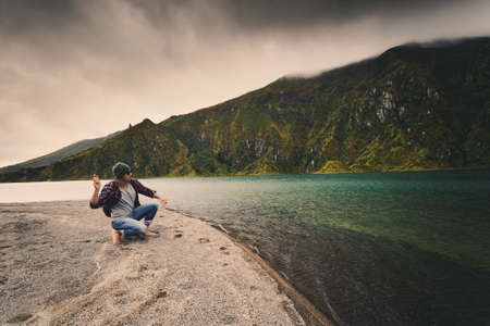 Man throwing a stone at the lake