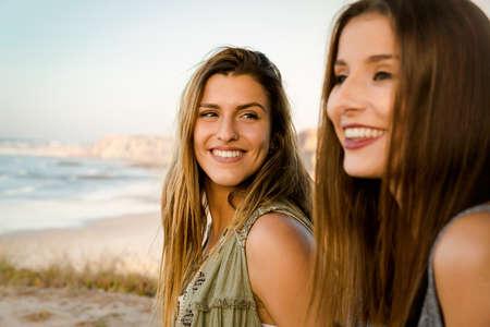 Two best friends near a beach having a good time