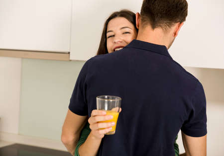 Embraced young couple on the kitchen