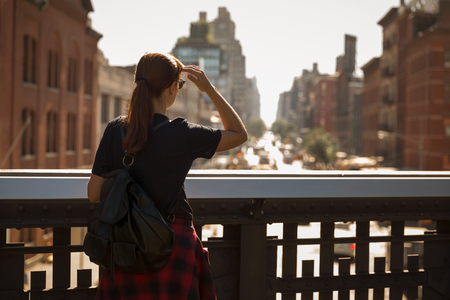 Woman enjoying the city view of Manhattan, NYC Stock Photo - 115304110