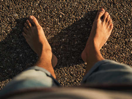 Barefoot feeling the hot road