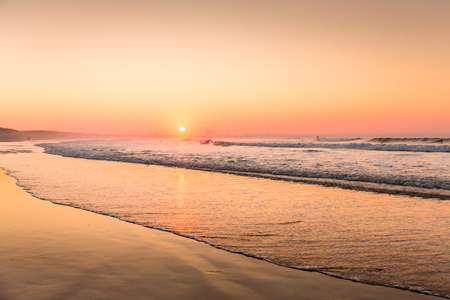 Beautiful sunset at the Portugal beach Imagens