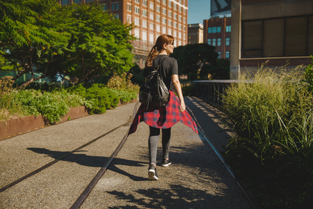 Beautiful woman walking on the HighLine Park, NYC