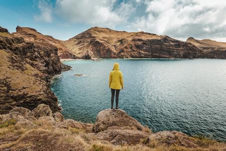 Young female traveler enjoying the nature