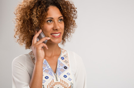 Beautiful African American woman talking on the phone