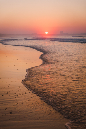 Beautiful sunset at the Portugal beach Imagens - 130782987