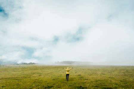 Woman felling the freedom on the nature Фото со стока