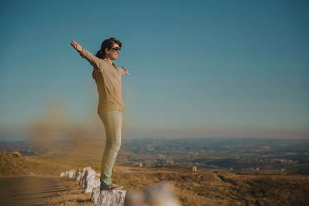 Woman enjoying the nature with arms raised