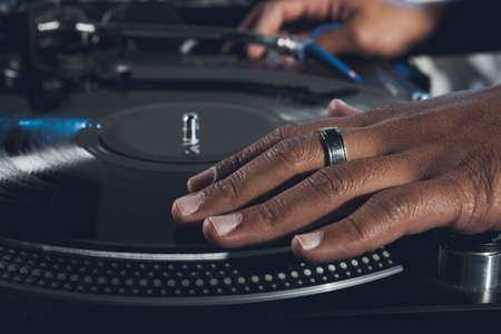 Dj mixes the track in the nightclub