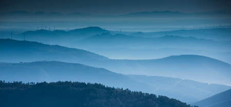Beautiful abstract monochrome mountain landscape in blue tonality