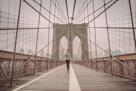 Woman practicing jogging on the Brooklyn bridge