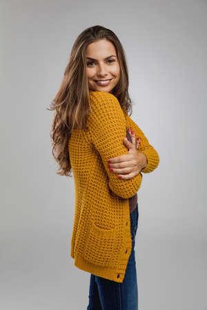 Shot of a beautiful young woman over a gray background Фото со стока
