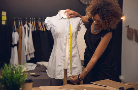 Young stylist designer on her atelier