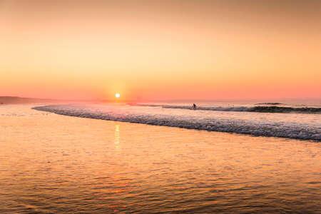 Beautiful sunset at the Portugal beach Фото со стока