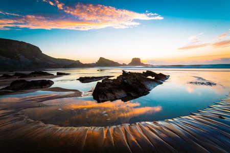Beautiful orange sunset at the beach Фото со стока