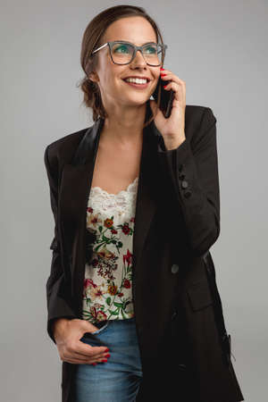 Shot of a beautiful young woman talking on her cellphone