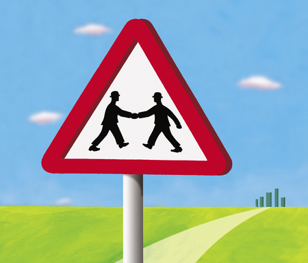 Two businessmen shaking hands inside give way sign
