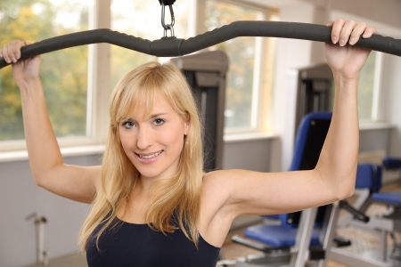 Blonde woman working out in gym photo