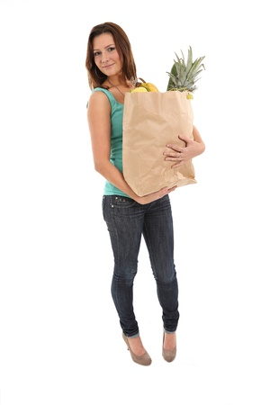 Happy woman with shopping bags and groceries photo