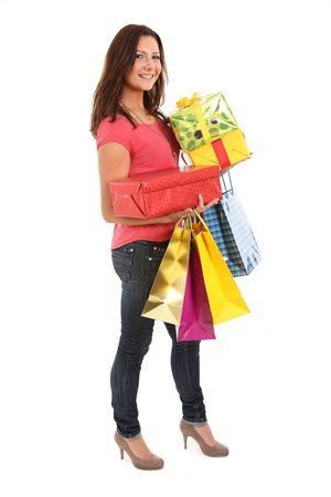 carries: Happy woman carries shopping bags and birthday or christmas presents