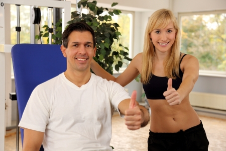 Personal trainer and athletic woman working out in a fitness center Stock Photo - 16715315
