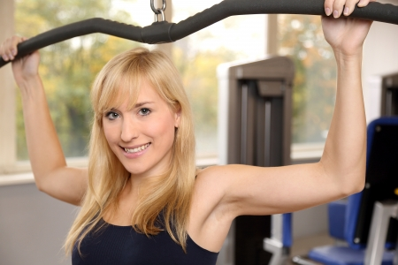 Beautiful young woman working out in a fitness center photo