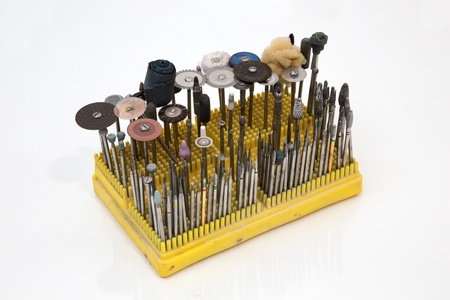 onlays: Equipment such as drills or grinders a used in a dental lab