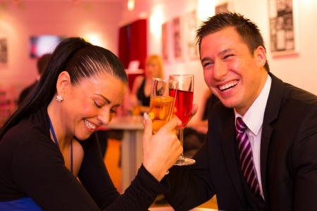 anniversary sexy: Couple in a bar enjoying themselves and drinking together