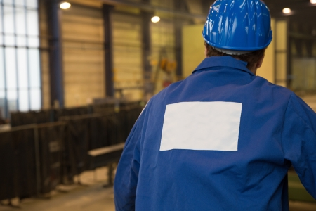 assembly hall: Construction worker looking at assembly hall or factory Stock Photo