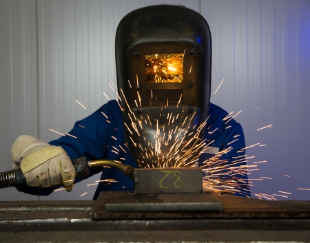 welding metal: Man with welding helmet welding steel Stock Photo
