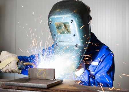 Man with welding helmet welding steel Stock Photo - 17800254
