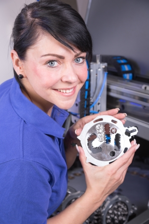 Dental technician working on a milling machine photo