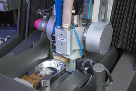 Milling or drilling machine in a dental lab photo