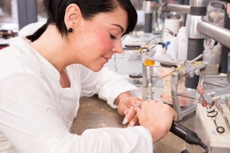 articulator: Technician in a dental lab working on a prosthesis Stock Photo