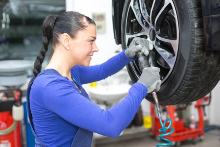 Mechanic changing the wheel on a car hydraulic lift Stock Photo - 18691745