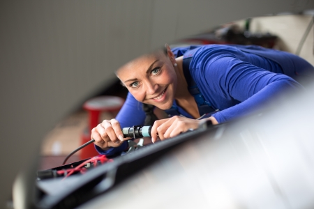 electrics: Car mechanics repairing car electrics and other parts of the motor