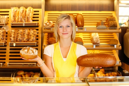 saleslady: Shopkeeper in bakery with two loafs of bread