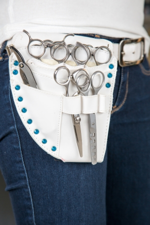 Hairdresser belt pouch with scissors photo