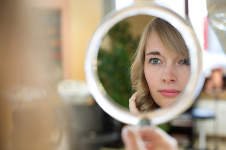 customer looking ar her new haircut in mirror Stock Photo - 19496489