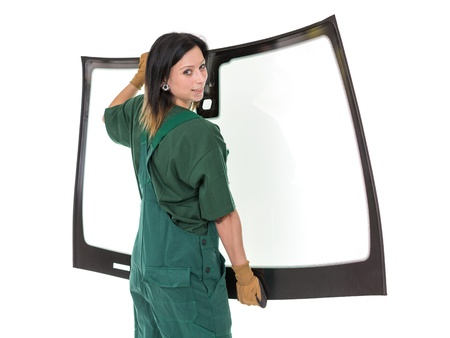 laborers: Worker glaziers workshop with car windscreen or windshield isolated in front of white background