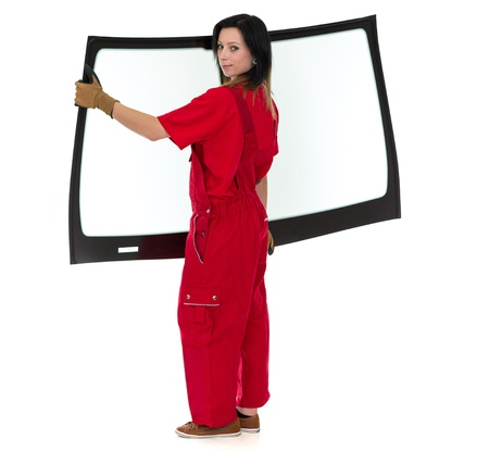 glazing: Worker glaziers workshop with car windscreen or windshield isolated in front of white background