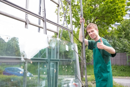glasscutter: Glaziers loading panes of glass on transportion trailer