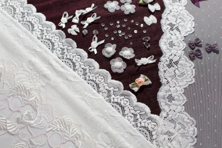 customization: Fabric, lingerie tull and different sewing supplies such as ribbons, roses and gemstones Stock Photo