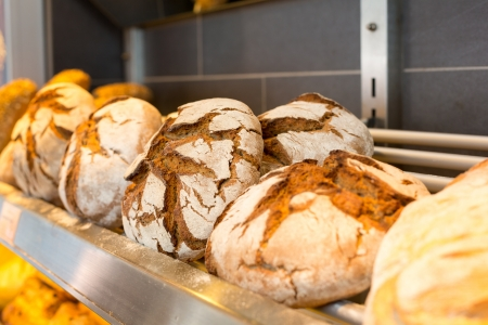 bakery store: Shelf filled with loafs of bread in a bakery Stock Photo