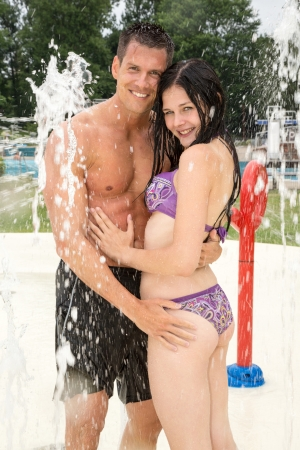 Couple at water park in a public swimming pool photo