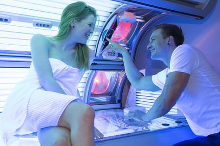 Couple in tanning salon at sunbed Standard-Bild