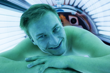 sunbed: Customer or client in a solarium on tanning bed Stock Photo