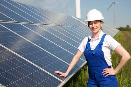 workmen: An engineer posing with solar energy panels