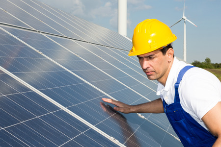 installer: An engineer or installer inspecting solar energy panels